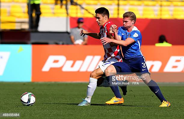 John Nelson of USA and Josip Brekalo of Croatia battle for the ball during the FIFA U17 Men's World Cup 2015 group A match between USA and Croatia at...