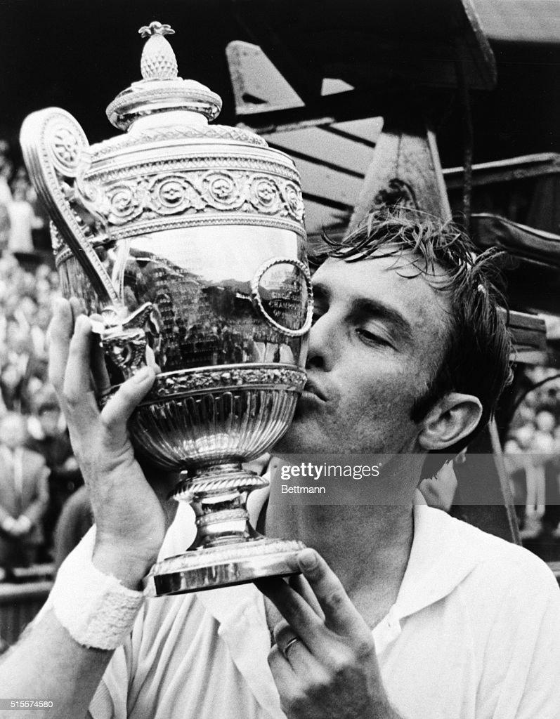 John New be Kisses Wimbledon Trophy