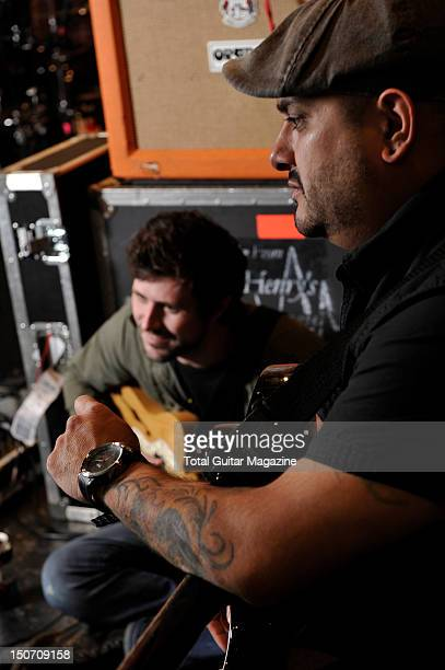 John Nolan and Eddie Reyes of American rock band Taking Back Sunday during a shoot for Total Guitar Magazine August 29 2011