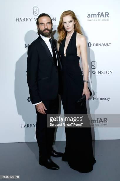 John Nollet and Alexina Graham attend the amfAR Paris Dinner 2017 at Le Petit Palais on July 2 2017 in Paris France