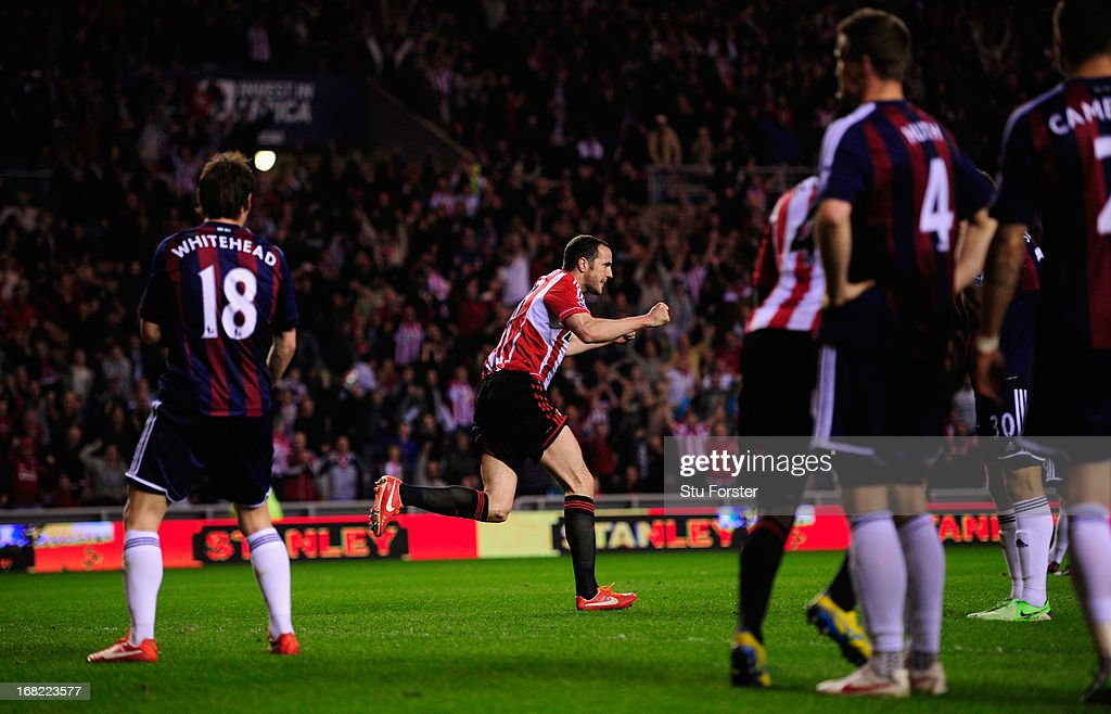 John O' Shea of Sunderland celebrates his goal during the Barclays Premier League match between Sunderland and Stoke City at the Stadium of Light on May 06, 2013 in Sunderland, England.