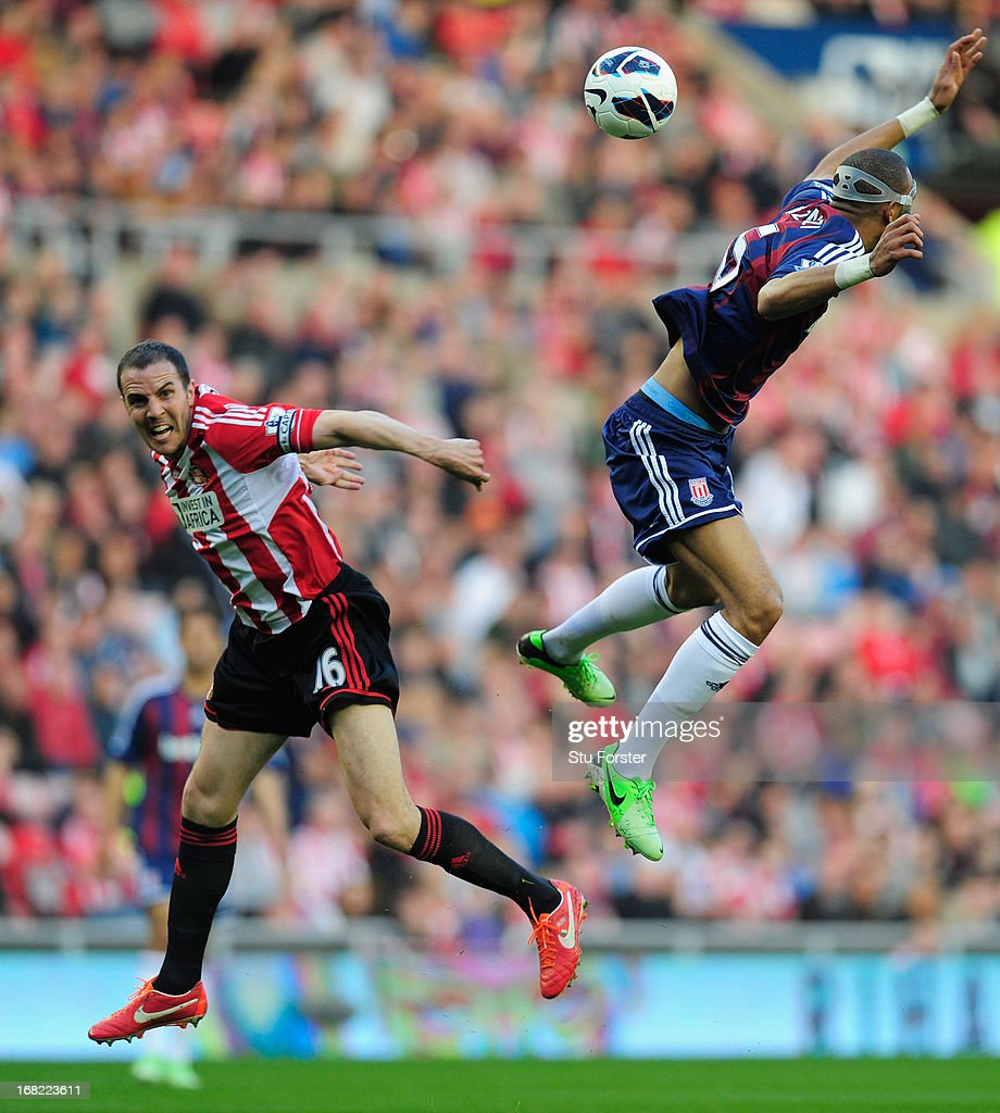 John O' Shea of Sunderland (l) challenges Steven N'Zonzi of Stoke during the Barclays Premier League match between Sunderland and Stoke City at the Stadium of Light on May 06, 2013 in Sunderland, England.