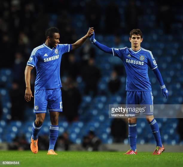 John Obi Mikel and Oscar of Chelsea celebrate at fulltime