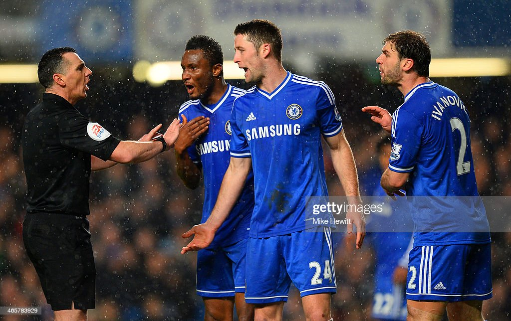 John Obi Mikel <a gi-track='captionPersonalityLinkClicked' href=/galleries/search?phrase=Gary+Cahill&family=editorial&specificpeople=204341 ng-click='$event.stopPropagation()'>Gary Cahill</a> and <a gi-track='captionPersonalityLinkClicked' href=/galleries/search?phrase=Branislav+Ivanovic&family=editorial&specificpeople=607152 ng-click='$event.stopPropagation()'>Branislav Ivanovic</a> of Chelsea appeal Referee Neil Swarbrick during the Barclays Premier League match between Chelsea and West Ham United at Stamford Bridge on January 29, 2014 in London, England.