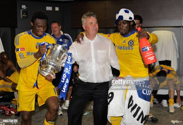 John Obi Mikel manager Guus Hiddink and Michael Essien of Chelsea celebrate victory in the dressing room after the FA Cup sponsored by EON Final...