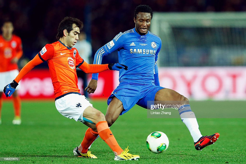John Obi Mikel (R) of Chelsea challenges Aldo De Nigris (L) of CF Monterrey during the FIFA Club World Cup Semi Final match between CF Monterrey and Chelsea at International Stadium Yokohama on December 13, 2012 in Yokohama, Japan.