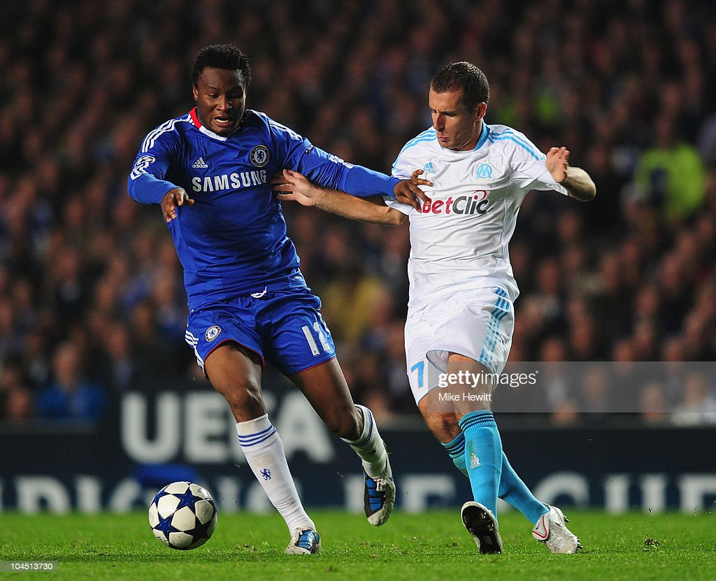John Obi Mikel of Chelsea is challenged by <a gi-track='captionPersonalityLinkClicked' href=/galleries/search?phrase=Benoit+Cheyrou&family=editorial&specificpeople=648473 ng-click='$event.stopPropagation()'>Benoit Cheyrou</a> of Marseille during the UEFA Champions League Group F match between Chelsea and Marseille at Stamford Bridge on September 28, 2010 in London, England.