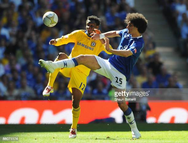 John Obi Mikel of Chelsea is challenged by Marouane Fellaini of Everton during the FA Cup sponsored by EON Final match between Chelsea and Everton at...