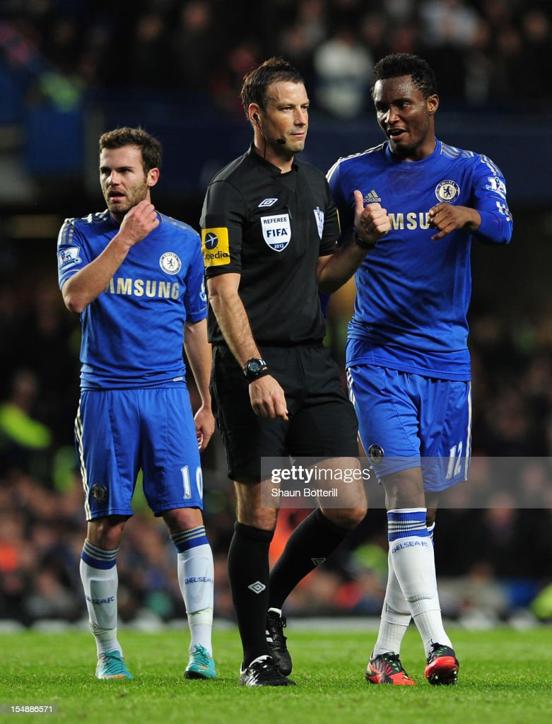 John Obi Mikel of Chelsea talks to referee <a gi-track='captionPersonalityLinkClicked' href=/galleries/search?phrase=Mark+Clattenburg&family=editorial&specificpeople=2108870 ng-click='$event.stopPropagation()'>Mark Clattenburg</a> as team mate <a gi-track='captionPersonalityLinkClicked' href=/galleries/search?phrase=Juan+Mata&family=editorial&specificpeople=4784696 ng-click='$event.stopPropagation()'>Juan Mata</a> looks on during the Barclays Premier League match between Chelsea and Manchester United at Stamford Bridge on October 28, 2012 in London, England.