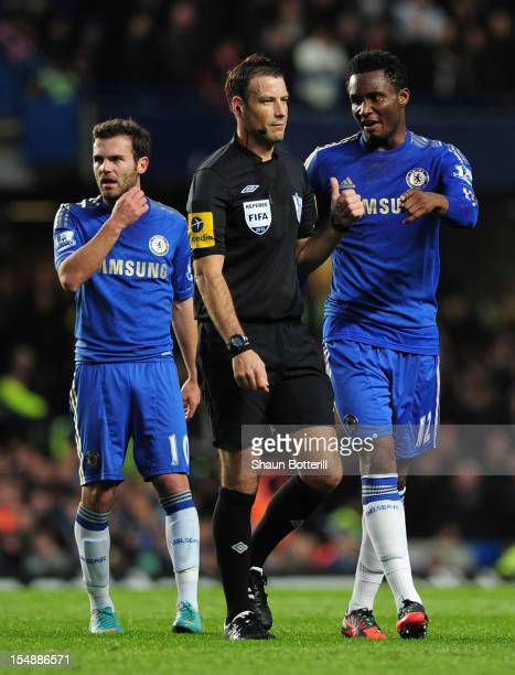 John Obi Mikel of Chelsea talks to referee Mark Clattenburg as team mate Juan Mata looks on during the Barclays Premier League match between Chelsea...