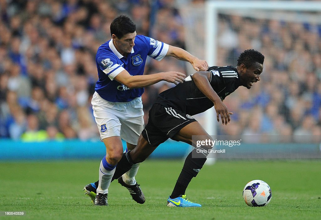 John Obi Mikel of Chelsea tangles with <a gi-track='captionPersonalityLinkClicked' href=/galleries/search?phrase=Gareth+Barry&family=editorial&specificpeople=209123 ng-click='$event.stopPropagation()'>Gareth Barry</a> of Everton during the Barclays Premier League match between Everton and Chelsea at Goodison Park on September 14, 2013 in Liverpool, England.