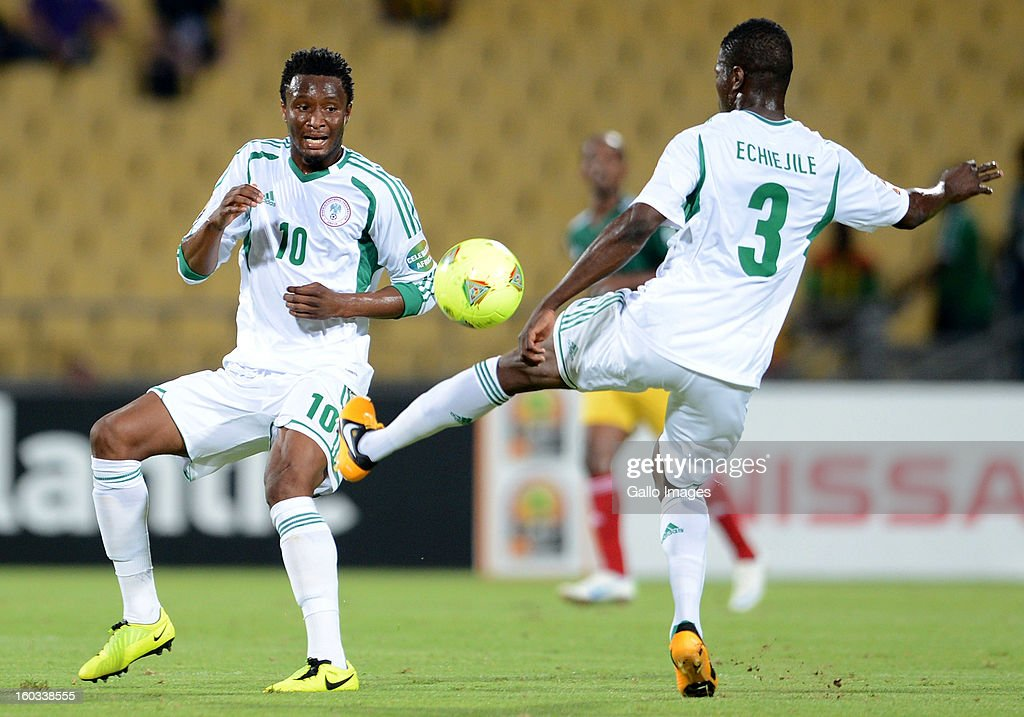 AFRICA - JANUARY 29, John Obi Mikel of Nigeria (L) in action during the 2013 African Cup of Nations match between Ethiopia and Nigeria at Royal Bafokeng Stadium on January 29, 2013 in Rustenburg, South Africa.
