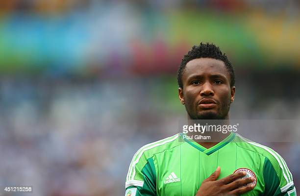 John Obi Mikel of Nigeria looks on during the National Anthem prior to the 2014 FIFA World Cup Brazil Group F match between Nigeria and Argentina at...