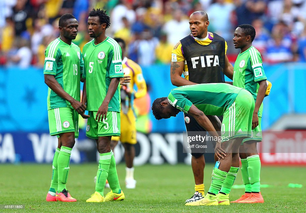John Obi Mikel of Nigeria reacts with teammates after being defeated by France 2-0 during the 2014 FIFA World Cup Brazil Round of 16 match between France and Nigeria at Estadio Nacional on June 30, 2014 in Brasilia, Brazil.
