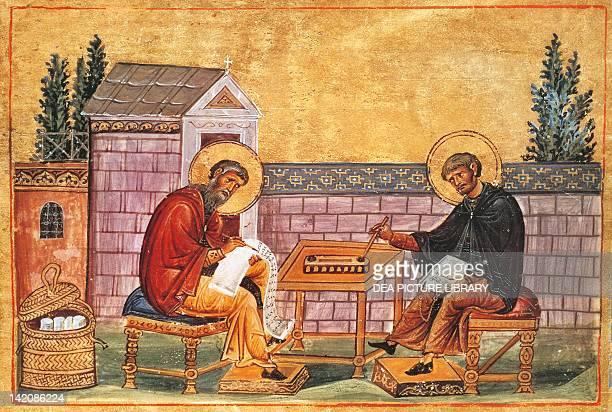 John of Damascus intent on writing miniature from Menologio for Basil II manuscript Vat Grec 1613 folio 213 10th11th Century