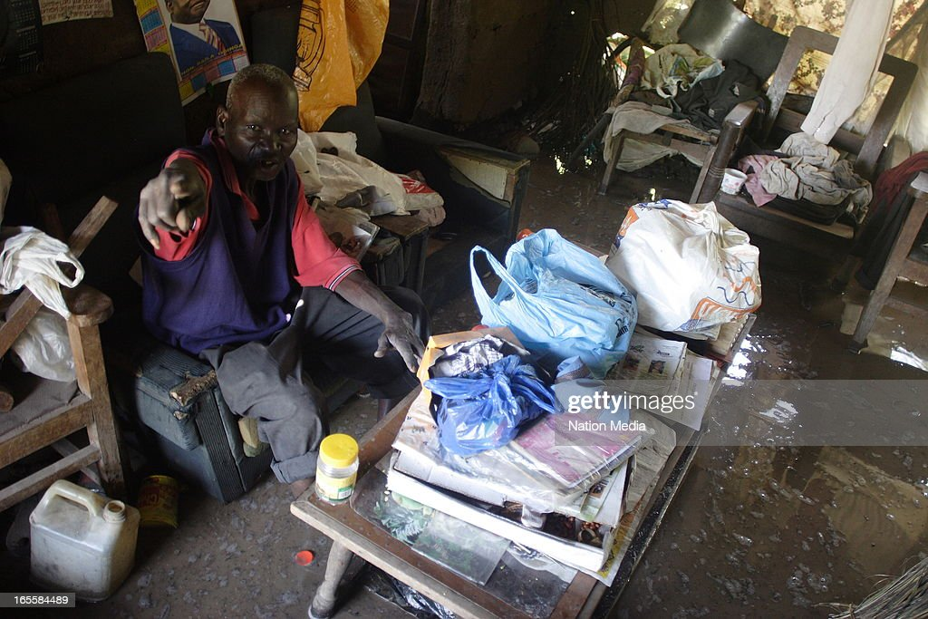 John Ogada inside his flooded hut on April 1, 2013 in Kisumu County, Kenya. Thousands of people have been displaced by the heavy rains with houses destroyed and livestock lost. At least 10 people have reportedly been killed by the floods.