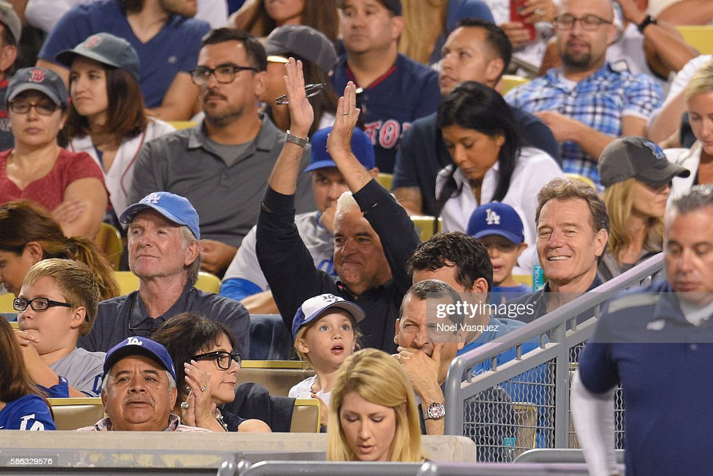 John O'Hurley and Bryan Cranston attend a baseball game between the Boston Red Sox and the Los Angeles Dodgers at Dodger Stadium on August 5 2016 in...