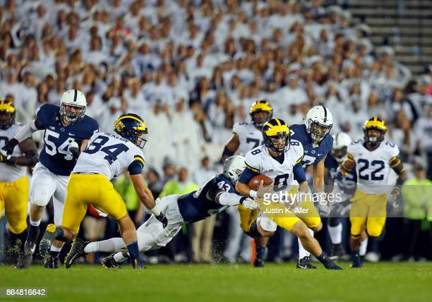 John O'Korn of the Michigan Wolverines rushes against the Penn State Nittany Lions on October 21 2017 at Beaver Stadium in State College Pennsylvania