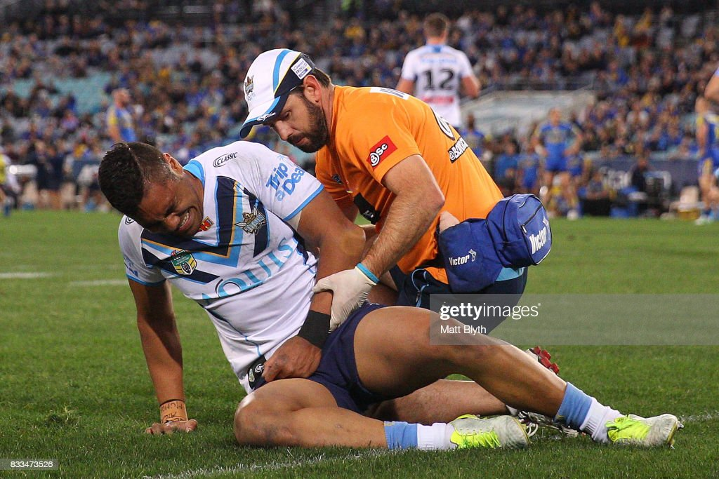John Olive of the Titans yells in pain after injuring his arm during the round 24 NRL match between the Parramatta Eels and the Gold Coast Titans at ANZ Stadium on August 17, 2017 in Sydney, Australia.