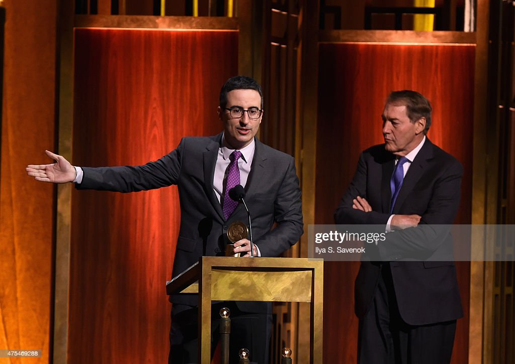 John Oliver accepts award onstage with Charlie Rose during The 74th Annual Peabody Awards Ceremony at Cipriani Wall Street on May 31 2015 in New York...