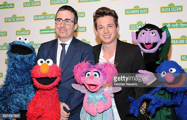 John Oliver and Charlie Puth with the Sesasme Street Muppets attend the 14th Annual Sesame Workshop Gala at Cipriani 42nd Street on June 1 2016 in...