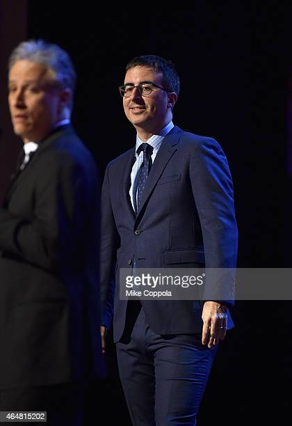 John Oliver and Jon Stewart perform onstage at Comedy Central Night Of Too Many Stars at Beacon Theatre on February 28 2015 in New York City