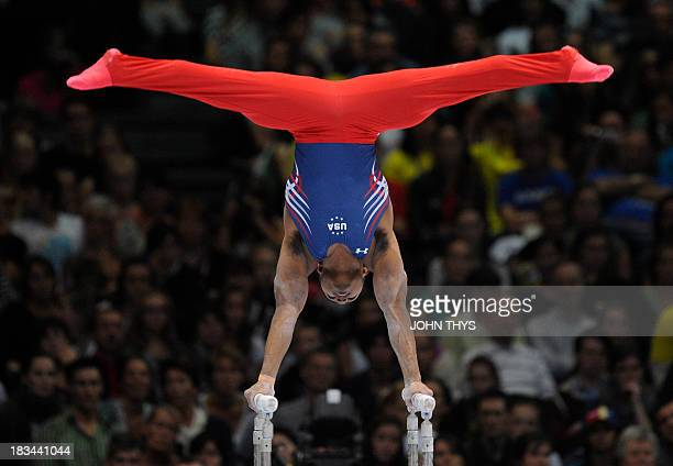 John Orozco of the US performs on the parallel bars during the men's final at the 44th Artistic Gymnastics World Championships in Antwerp on October...