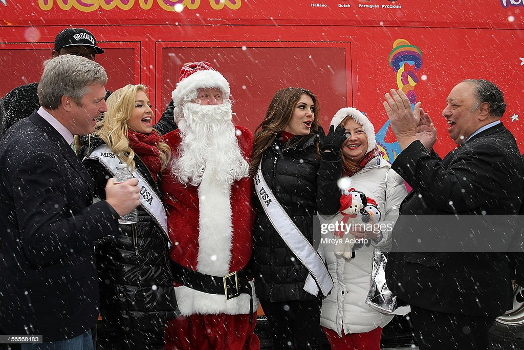 John Osborn, Cassidy Wolf, Santa Claus, Erin Brady, Mrs. Claus and John Catsimatidis attend CitySightseeing New York 2013 holiday toy drive at PAL's Harlem Center on December 14, 2013 in New York City.