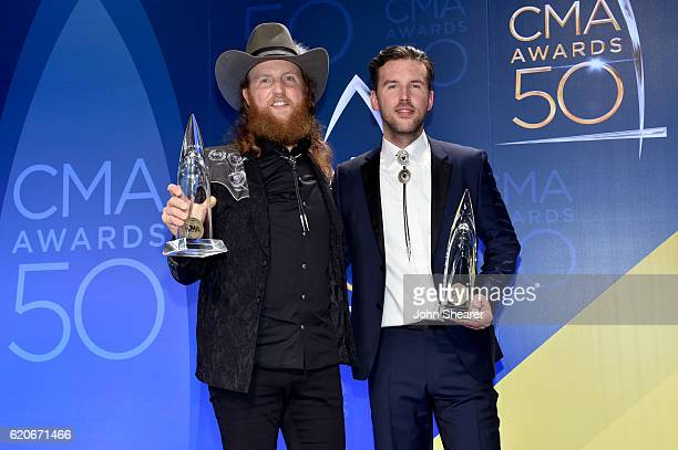 John Osborne and TJ Osborne of musical duo Brothers Osborne pose in the press room at the 50th annual CMA Awards at the Bridgestone Arena on November...