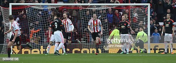 John O'Shea and Jan Kirchhoff of Sunderland celebrate Wahbi Khazri scoring their first goal during the Barclays Premier League match between...