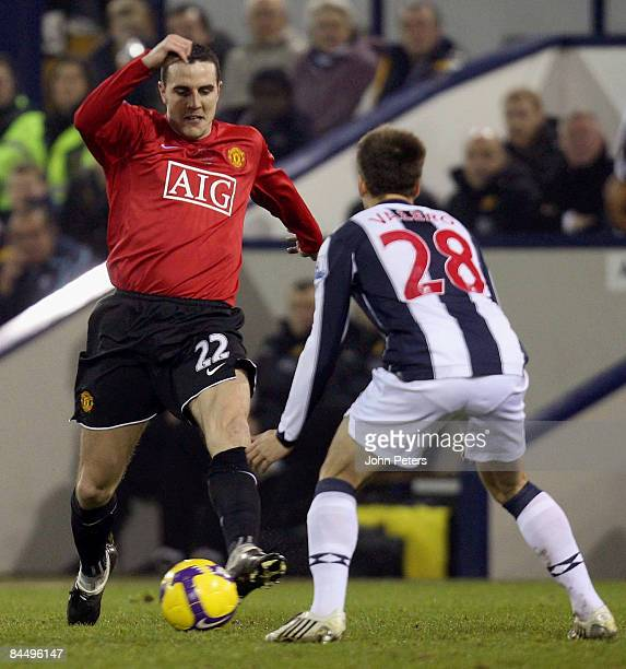 John O'Shea of Manchester United clashes with Borja Valero of West Bromwich Albion during the Barclays Premier League match between West Bromwich...