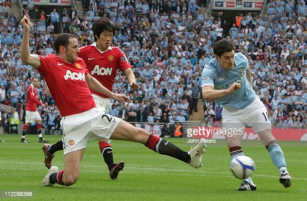 John O'Shea of Manchester United clashes with Gareth Barry of Manchester City during the FA Cup sponsored by Eon SemiFinal match between Manchester...
