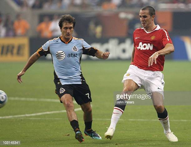 John O'Shea of Manchester United clashes with Guillermo Barros Schelotto of MLS Allstars during the MLS AllStar match between Manchester United and...