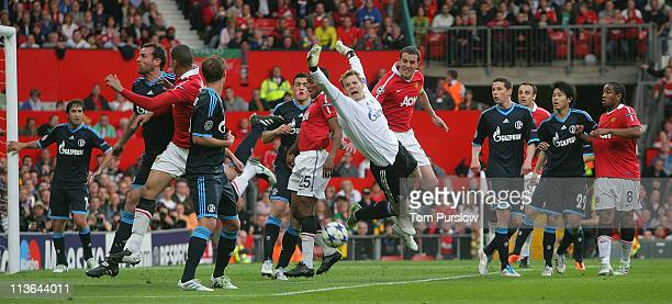 John O'Shea of Manchester United clashes with Manuel Neuer of Schalke 04 during the UEFA Champions League SemiFinal second leg match between...