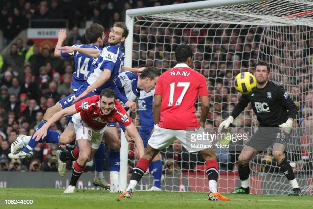 John O'Shea of Manchester United clashes with Roger Johnson of Birmingham City during the Barclays Premier League match between Manchester United and...