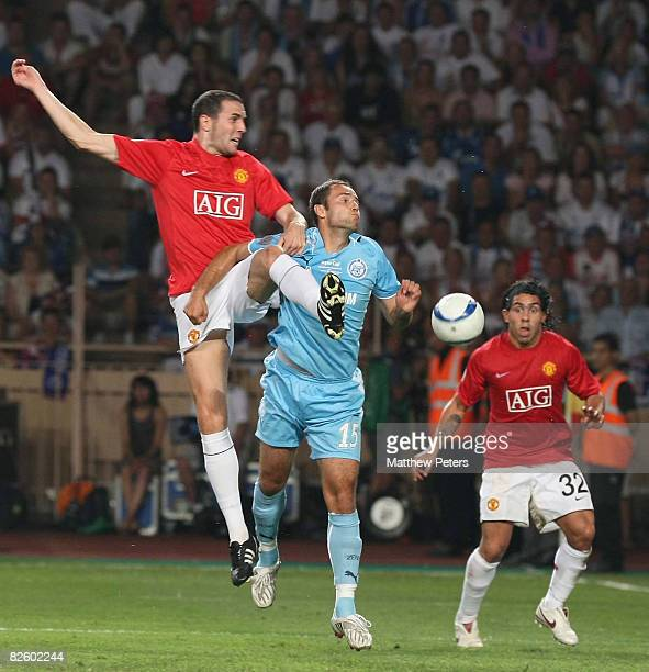 John O'Shea of Manchester United clashes with Roman Shirkov of Zenit St Petersburg during the UEFA Supercup match between Manchester United and Zenit...
