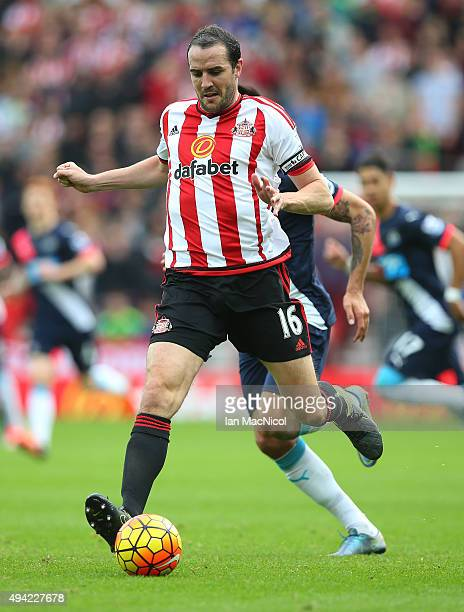 John O'Shea of Newcastle United controls the ball during the Barclays Premier League match between Sunderland and Newcastle at The Stadium of Light...