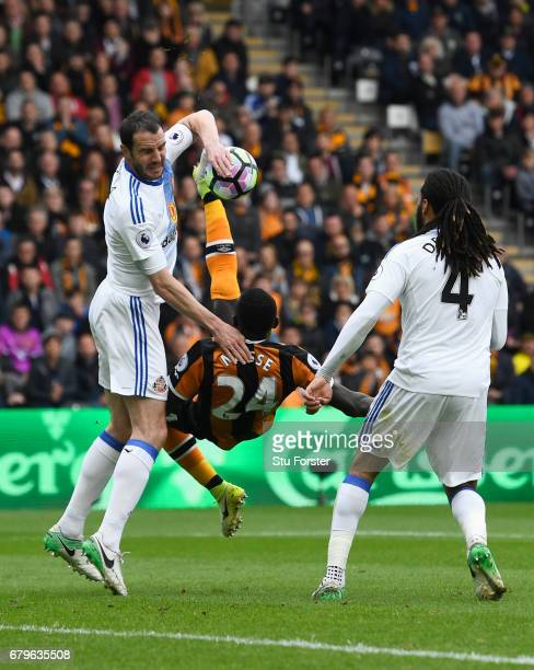 John O'Shea of Sunderland appears to handle the ball while Oumar Niasse of Hull City attempts a over head kick during the Premier League match...