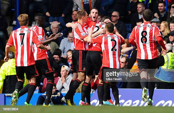 John O'Shea of Sunderland celebrates the own goal scored by Cesar Azpilicueta of Chelsea with team mates during the Barclays Premier League match...