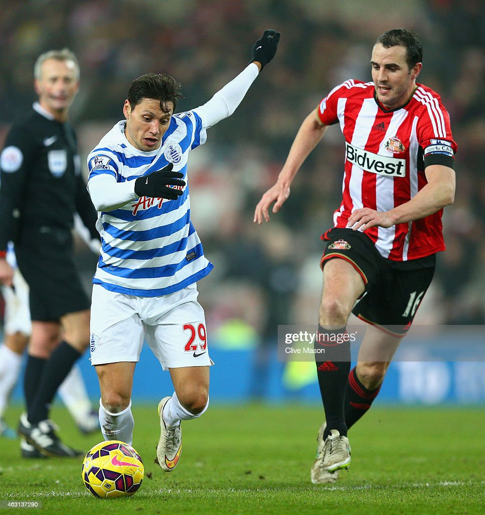 John O'Shea of Sunderland tracks Mauro Zarate of QPR during the Barclays Premier League match between Sunderland and Queens Park Rangers at Stadium of Light on February 10, 2015 in Sunderland, England.