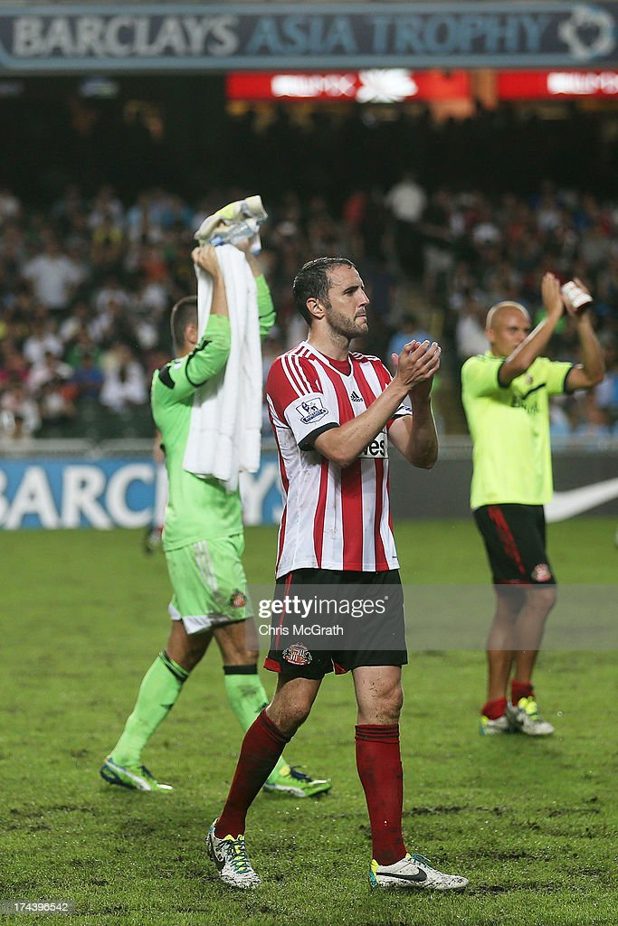 John O'Shea of Sunderland waves to the crowd during the Barclays Asia Trophy Semi Final match between Tottenham Hotspur and Sunderland at Hong Kong Stadium on July 24, 2013 in So Kon Po, Hong Kong.