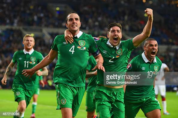 John O'Shea of the Republic of Ireland celebrates scoring the stoppage time equaliser with Stephen Ward and Jon Walters of the Republic of Ireland...