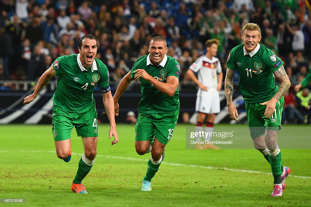 John O'Shea of the Republic of Ireland celebrates scoring the stoppage time equaliser with James McClean and Jon Walters of the Republic of Ireland...