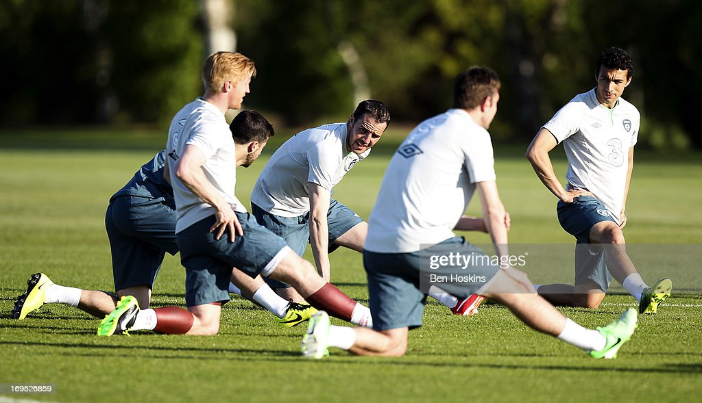 John O'Shea (3rd L) of the Republic of Ireland stretches alongside other squad members during an Ireland training session at Watford FC Training Ground on May 26, 2013 near St Albans, London Colney, England.
