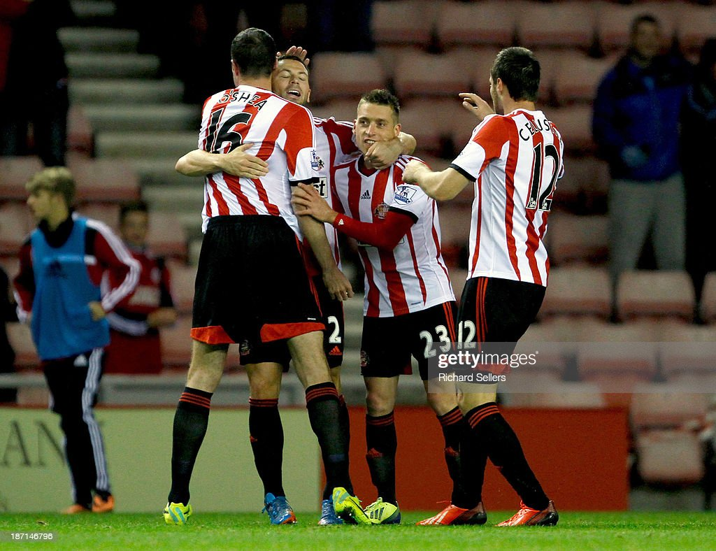 John O'shea, Phil Bardsley, <a gi-track='captionPersonalityLinkClicked' href=/galleries/search?phrase=Emanuele+Giaccherini&family=editorial&specificpeople=6675873 ng-click='$event.stopPropagation()'>Emanuele Giaccherini</a> and Ondrej Celustka celebrate after scoring a goal during the Capital One Cup fourth Round match between Sunderland and Southampton at Stadium of Light on November 06, 2013 in Sunderland, England.
