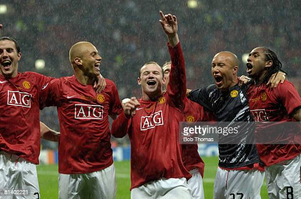 John O'Shea Wes Brown Wayne Rooney Darren Fletcher behind Mikael Silvestre and Anderson of Manchester United celebrate victory in the UEFA Champions...