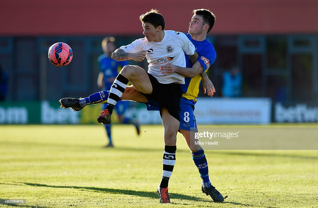 John Oster of Gateshead is challenged by Nathan Burke of Warrington during the FA Cup Second Round tie between Gateshead FC v and Warrington Town at...
