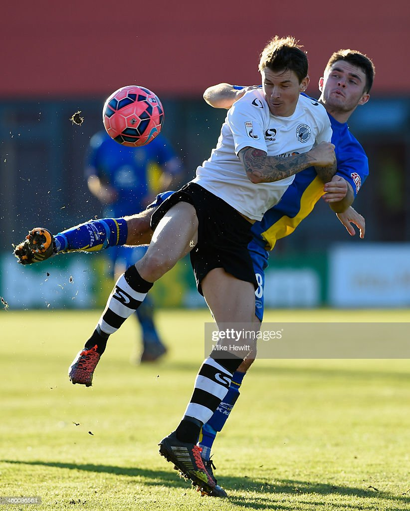 John Oster of Gateshead is challenged by Nathan Burke of Warrington during the FA Cup Second Round tie between Gateshead FC v and Warrington Town at the Gateshead International Stadium on December 7, 2014 in Gateshead, England.