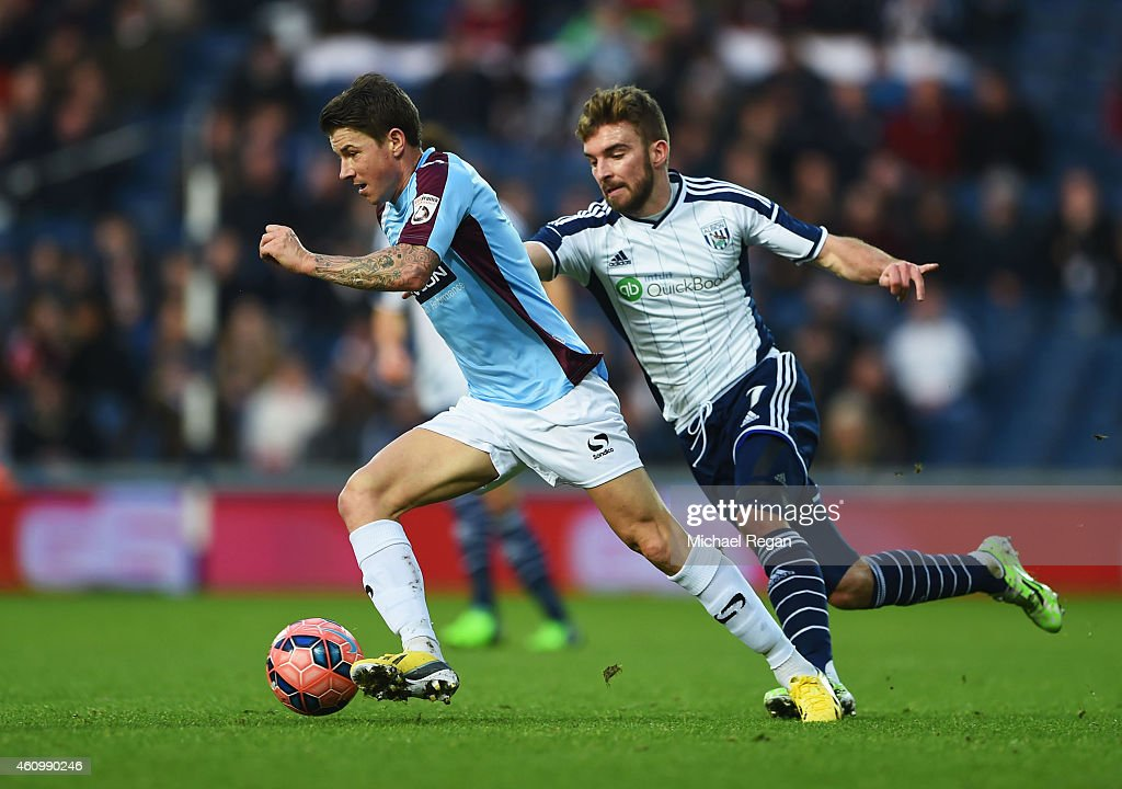 John Oster of Gateshead takes on James Morrison of West Bromwich Albion during the FA Cup Third Round match between West Bromwich Albion and...