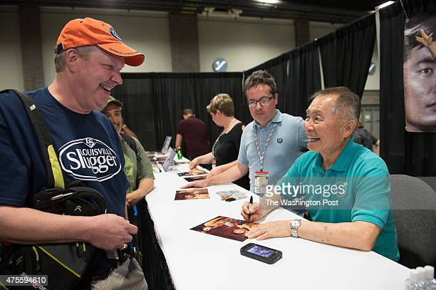John Ownby from Richmond Va receives an autograph from George Takei who played Hikaru Sulu helmsman of the USS Enterprise in the television series...